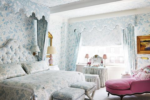 in the roses' bedroom, an antique chaise in a deep azalea shade scalamandré is a vivid foil for quadrille's pastel print dressing the walls, windows, and bed