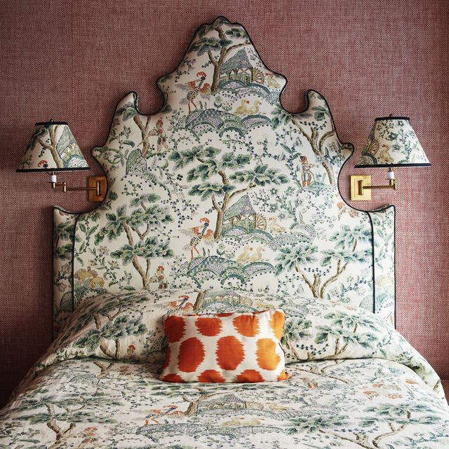 a warm basket weave wallpaper and archival english fabric in the guest room