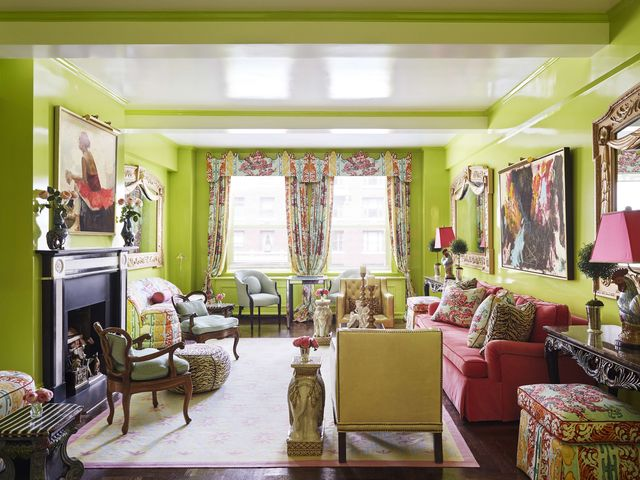 vivid dragon print draperies jim thompson and glossy apple green walls cloak the living room in a carousal of color