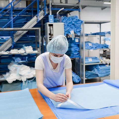 Manufacturing face masks at Zdravmedtech garment factory in Novosibirsk Region, Russia