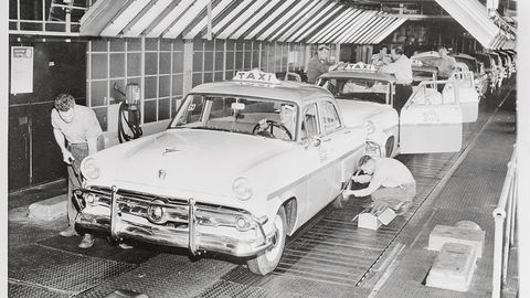 Employees Working on Car Assembly Line