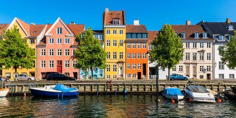 Colourful houses along canal in Copenhagen Denmark