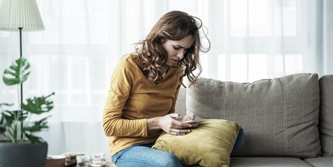 Worried lady messaging on mobile phone