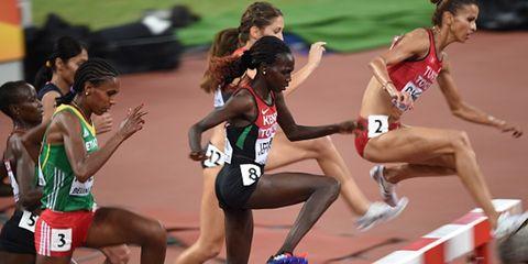 Sports uniform, Track and field athletics, Shoe, Sport venue, Race track, Athlete, Athletic shoe, Human leg, Running, Hurdle,