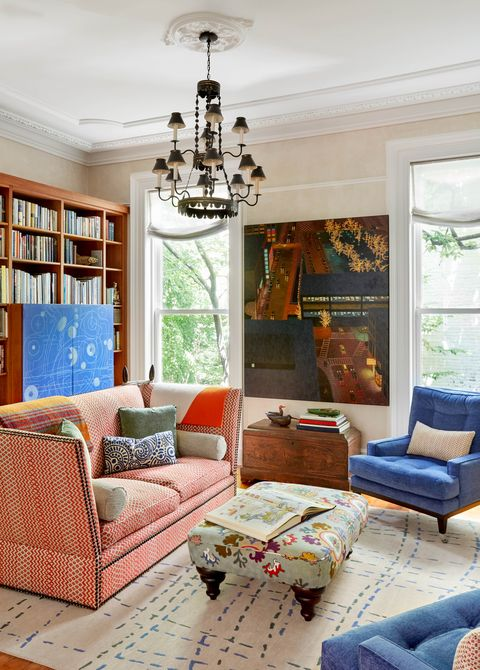kathleen walsh living room, pink couch, blue chairs, cream walls, floral ottoman