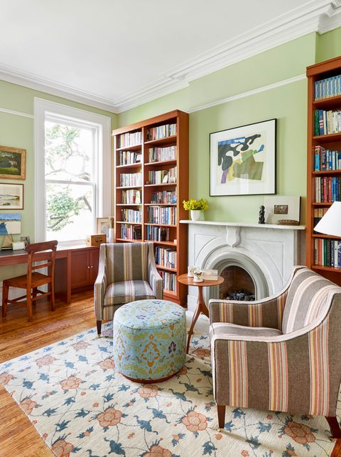 kathleen walsh office, green paint walls, white fireplace, striped chairs, floral ottoman, floral rug