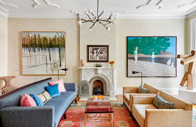 kathleen walsh living room, cream painted walls, blue couch, dusty pink chairs, artwork, statues