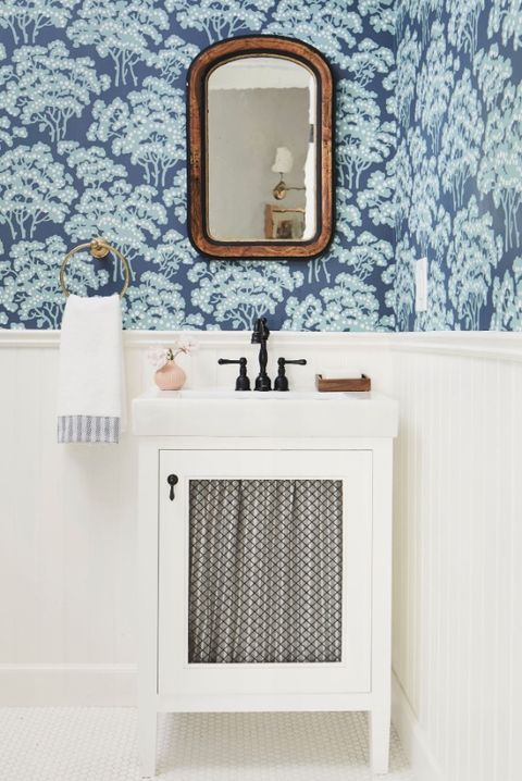 blue flower wallpaper with white toilet and sink