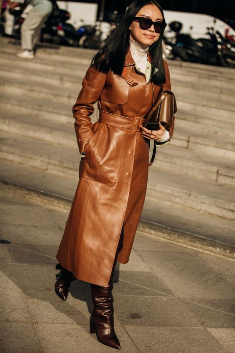 Clothing, Street fashion, Fashion, Fashion model, Brown, Footwear, Outerwear, Eyewear, Leather, Trench coat,