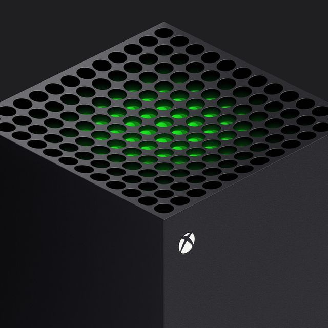 xbox series x console with glowing green light on the top