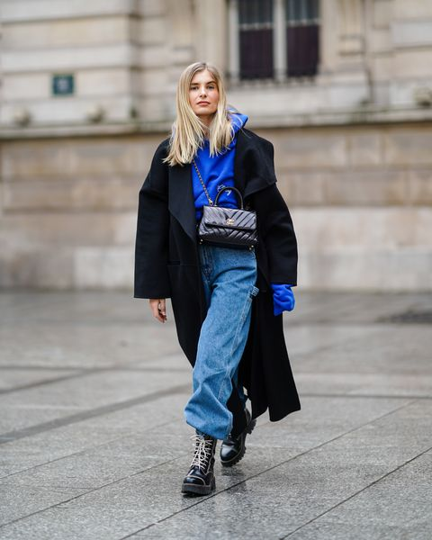 baggy jeans in hoge boots fashion week trend