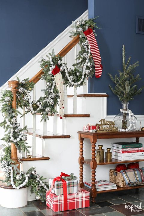 white and silver christmas stair decor