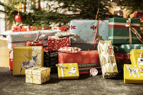 Christmas Presents Under Tree.Could A Present Pre Nupp Relieve Your Financial Worries
