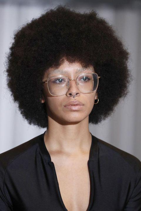 Eyewear, Glasses, Vision care, Hairstyle, Chin, Collar, Black hair, Style, Afro, Jheri curl,
