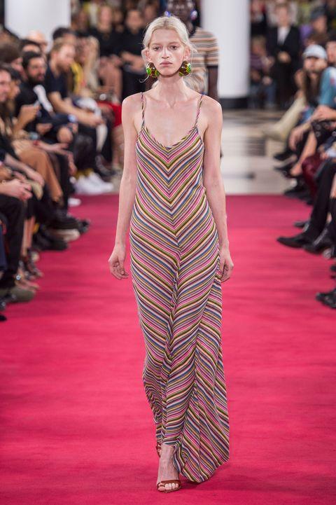 Fashion model, Fashion, Runway, Fashion show, Clothing, Dress, Red carpet, Haute couture, Shoulder, Flooring,