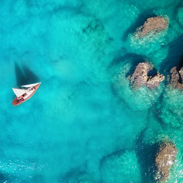 yacht on the sea from top view turquoise water background from top view summer seascape from air travel concept and idea