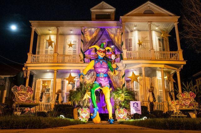 """a new orleans home decorated for mardi gras 2021, also known as """"yardi gras"""""""