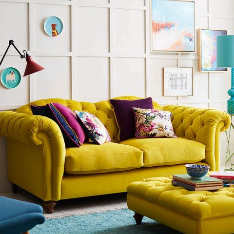 Couch, Living room, Furniture, Yellow, Room, Turquoise, Interior design, Orange, Sofa bed, studio couch,