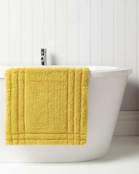 yellow bath mat, christy