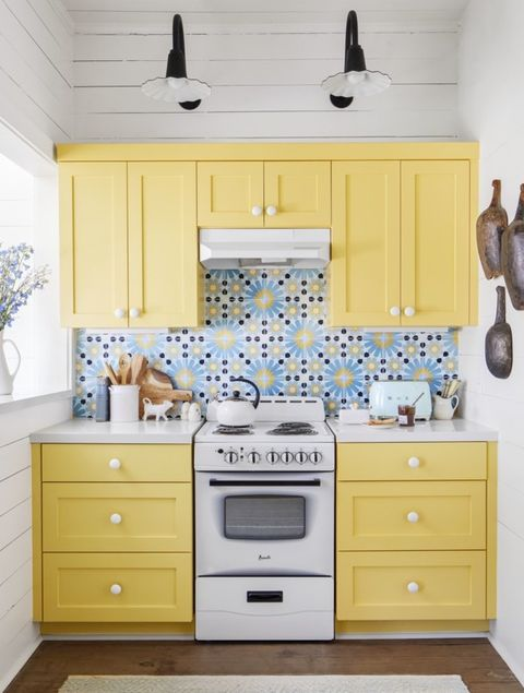 yellow cabinets and patterned tile in a small kitchen