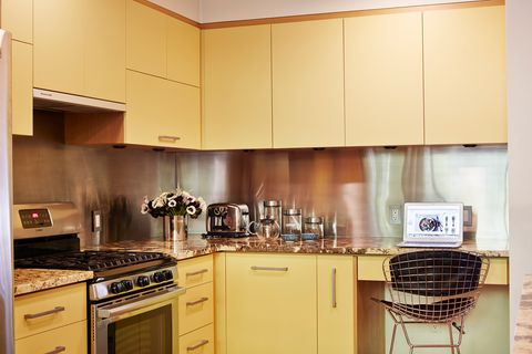 Countertop, Cabinetry, Kitchen, Property, Room, Furniture, Kitchen stove, Kitchen appliance, Yellow, Major appliance,