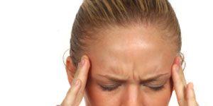 Headaches and Yoga: Woman with headache