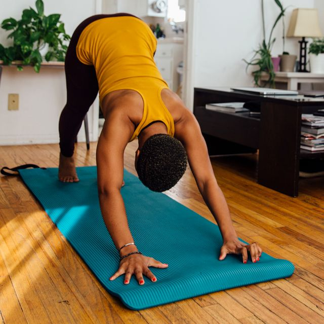 woman doing yoga in her living room