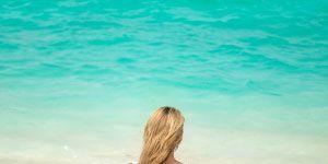 Beach Yoga: Woman doing yoga on the beach