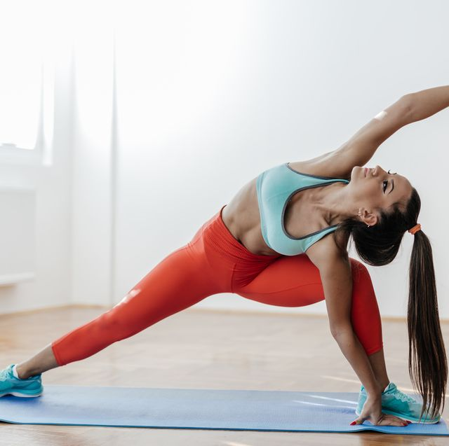 yoga practicing in her living room