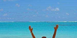 Vacation yoga: woman doing beach yoga
