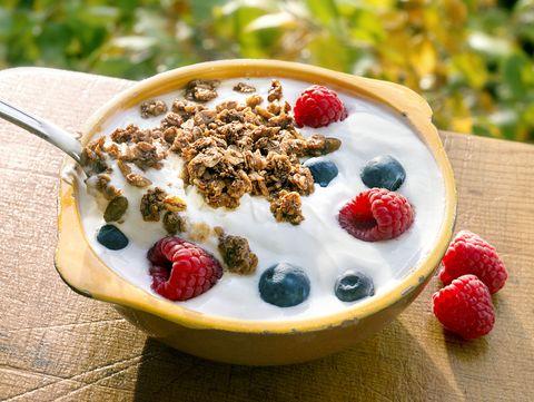 yogurt berries granola outside
