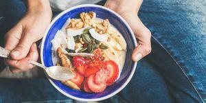 Yogurt, granola, seeds, fresh, dry fruits and honey in bowl