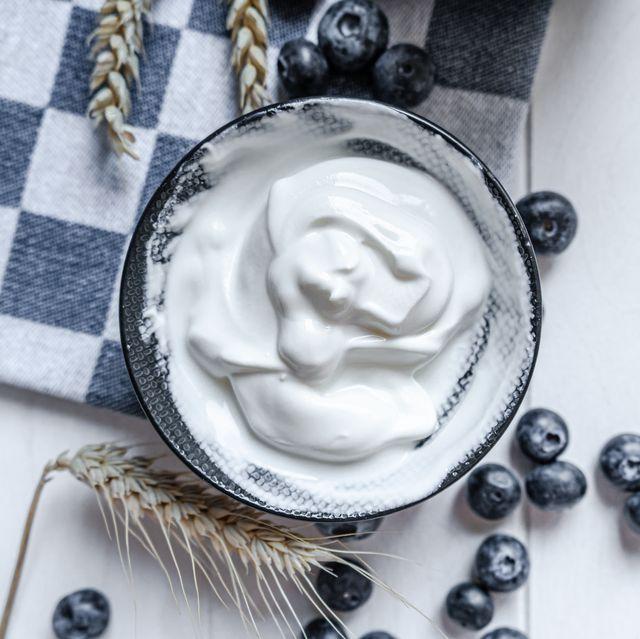 yogurt in bowl on wooden table healthy eating