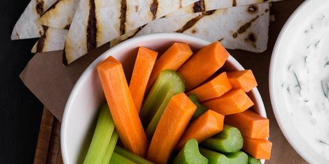 Yogurt sauce with parsley served with fresh carrot and celery sticks