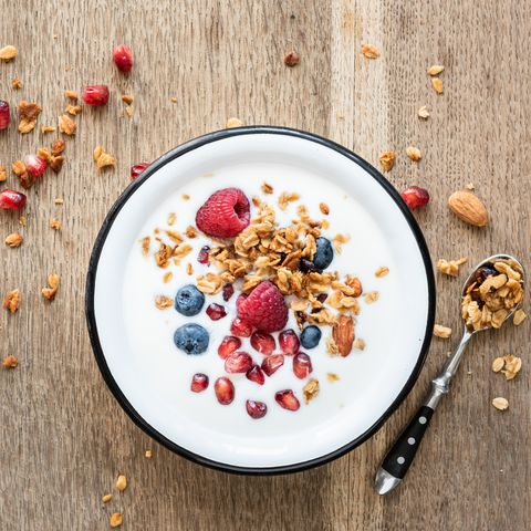 Yogurt with granola, pomegranate seed and berries