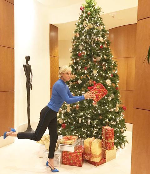 Christmas decoration, Event, Christmas tree, Standing, Christmas ornament, Interior design, Interior design, Elbow, Holiday, Holiday ornament,
