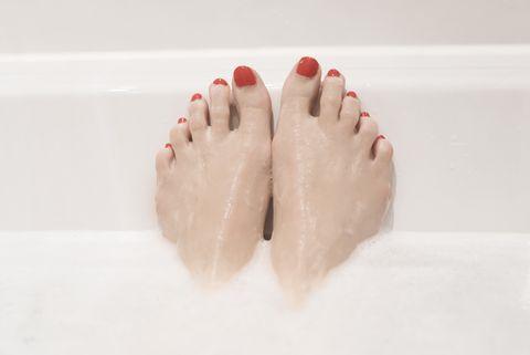 woman's feet in the bath