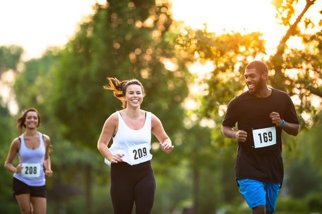young adults running a marathon stock photo