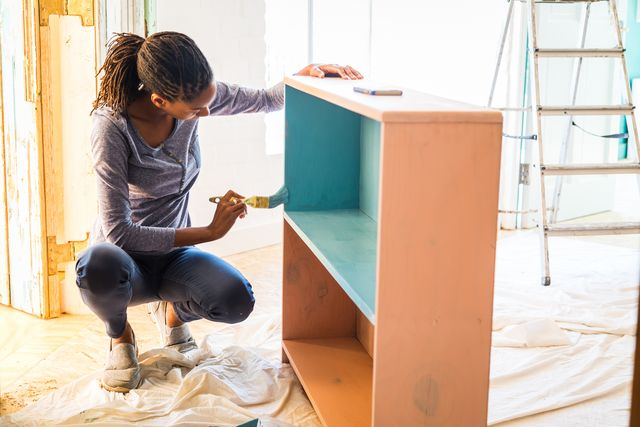 young caribean woman renovating her home