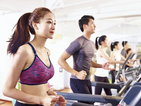 young asian adults exercising in gym