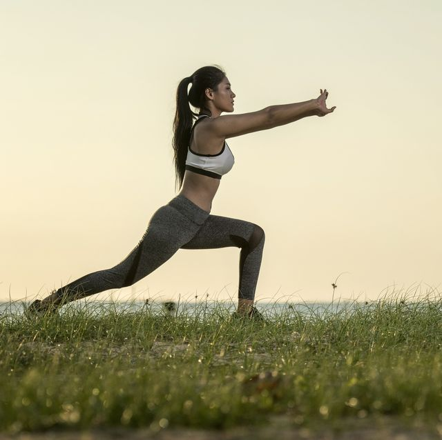 young asian models yoga beautiful teenage girl in sports clothing training yoga position on the mat the beach during sunset time