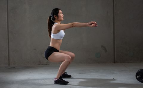 a young asian woman is doing stretching training