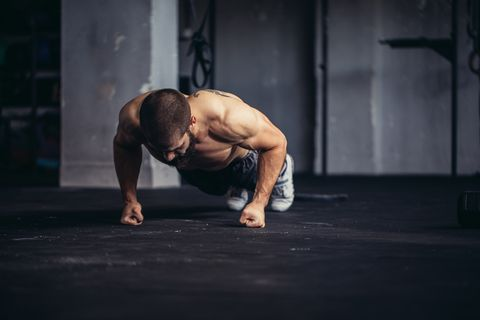 Young athlete doing push-ups