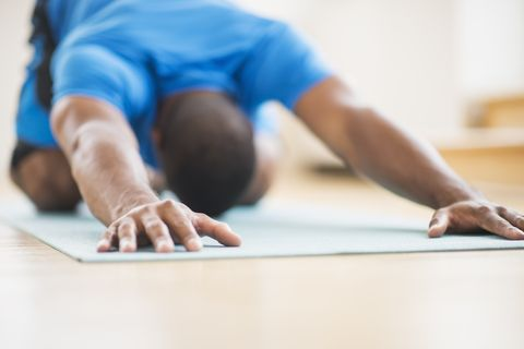 Young athlete man exercising at home