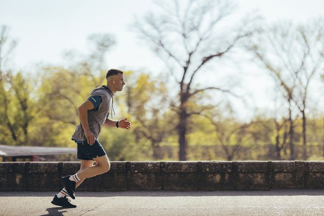 young athlete running alone in nature