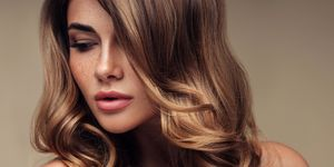 Young beautiful model with long wavy well groomed hair
