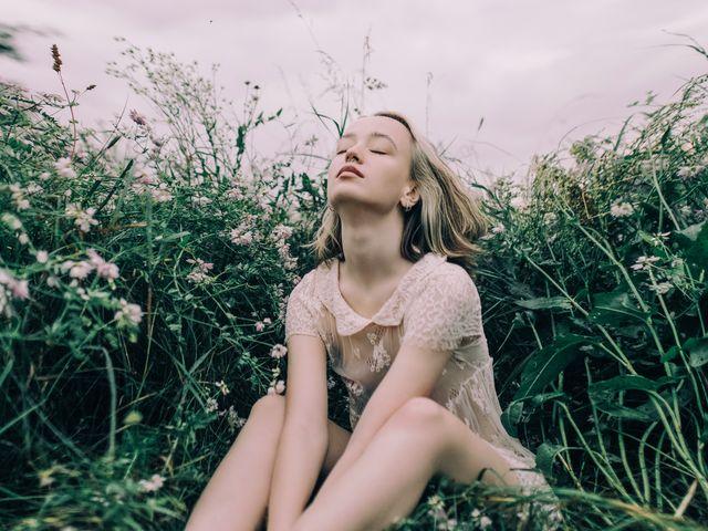 young beautiful woman enjoying the calm meadow
