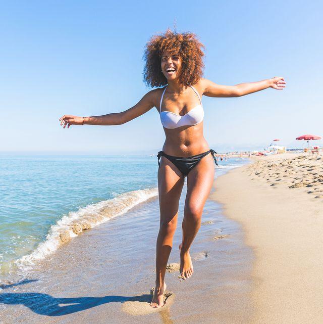 young black woman having fun at seaside