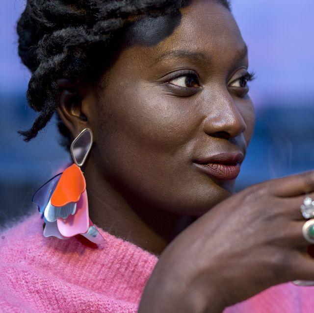 young black woman having tea