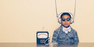 Young Boy Dressed as Nerd with Alien Headphones